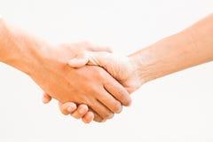 Stringere le mani, isolate su bianco Fotografia Stock