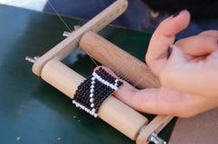 Stringing beads Royalty Free Stock Photo