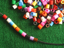 Stringing beads Stock Images