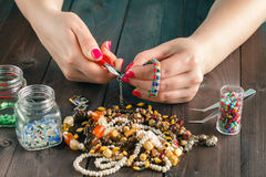 Stringing beads on the needle Royalty Free Stock Photography