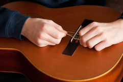 Stringing a classical guitar, close up Stock Image