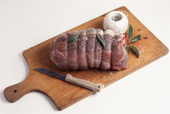 Stringing a haunch of venison. Food, gastronomy,culinary,cookery royalty free stock image