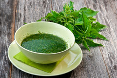 Stringing nettle soup Royalty Free Stock Photo