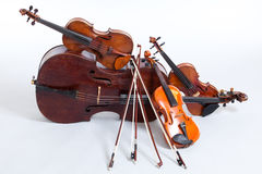 Strings. Cello and three violins, all vintage instruments Royalty Free Stock Photo