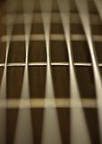 Strings. Macro of a 6-strings bass guitar stock images