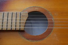 The strings on the guitar. The strings on an acoustic guitar stock images
