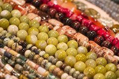 Strings of beads make cool pattern. Lots of strings of beads made from natural stones Stock Photography