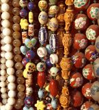 Strings of Chinese colorful handmade beads Stock Photos