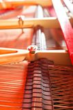 Strings close-up. Vintage red classical grand piano. Musical instrument abstract. stock photos