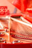 Strings close-up. Vintage red classical grand piano. Musical instrument abstract. stock photo