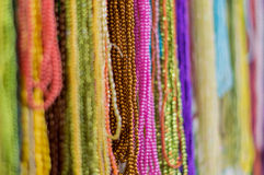 Strings of colorful beads hung at outdoor crafts market Stock Photography