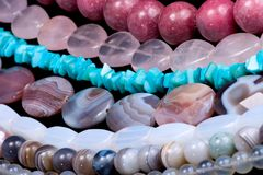 Strings of gem stones beds Royalty Free Stock Photo
