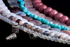 Strings of gem stones beds Stock Photo