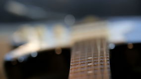 Strings of guitar in close-up. Strings of guitar vibrating in close-up stock footage
