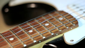 Strings of guitar in close-up stock video footage