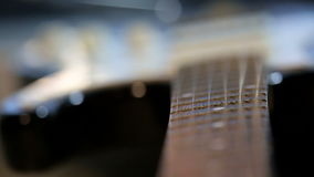 Strings of guitar in close-up. Strings of guitar vibrating in close-up stock video
