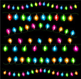 Strings of holiday lights on black background. Royalty Free Stock Photos
