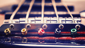 Strings of a Jazz Bass Guitar. Closeup view on details of strings of jazz bass guitar Royalty Free Stock Photos