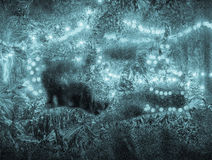 Strings of light through an icy window. Lights and ice make a great texture and background Stock Image