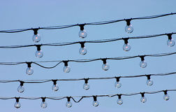 Strings of lights. Against blue sky Royalty Free Stock Photography