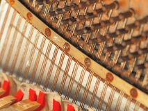 Strings and mechanics of a desolate old weathered piano. Melbourne 2017 royalty free stock image