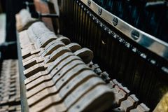 The strings of the old piano stock photos