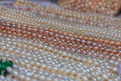 Strings of pearls at the market Royalty Free Stock Photos