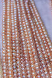 Strings of pearls at the market Stock Photography