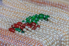 Strings of pearls at the market Royalty Free Stock Photo