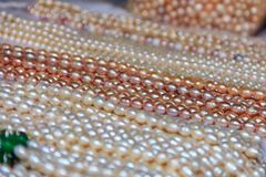 Strings of pearls at the market in Gulangyu Island in China Royalty Free Stock Photography