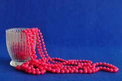 Strings of pink beads displayed in a fancy glass pot Royalty Free Stock Photography