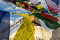 Strings of prayer flags on the background of the Buddhist stupa Royalty Free Stock Photos