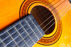 Strings, rose and neck of a yellow and orange guitar. Stock Photography