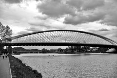 Arch bridge in Prague. Strings of suspended bridge spanning the river Royalty Free Stock Photography