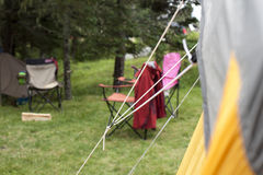 Strings of a tent with blurry campground Royalty Free Stock Image