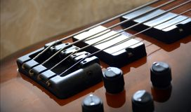 Vintage Tobacco Bass Guitar. 4 Strings Tobacco Bass Guitar with black accessories royalty free stock photos
