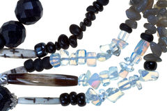 Strings of transparent and black stone and bone bu Stock Photo