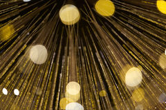 Strings of yellow-gold lights, abstract. Strings of cascading yellow-gold lights; abstract; isolated on a black background Stock Photos