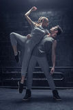 Stringy dancers performing in interaction with each other Stock Photo