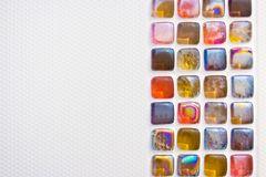 A strip of beauty small colored square mosaic caramel tiles in the bathroom, toilet, kitchen and any wall decoration royalty free stock image