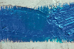 Strip of blue paint on the wall Stock Image