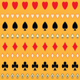 Strip card suits on gold background. Royalty Free Stock Photo