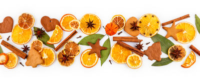 Strip of dried oranges, lemons, mandarins, star anise, cinnamon sticks and gingerbread, isolated on white Stock Photography