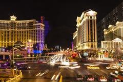 The strip in Las Vegas at night. LAS VEGAS - JUNE 15: In this time lapse image, traffic travels along the Las Vegas strip on June 15, 2012 in Las Vegas, Nevada Stock Image