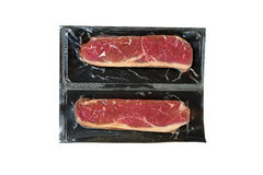 Strip loin steak in plastic wrap Royalty Free Stock Image