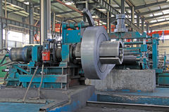 Strip and mechanical equipment in a factory Royalty Free Stock Image