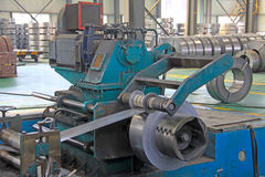 Strip and mechanical equipment in a factory Royalty Free Stock Photos