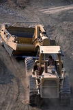 Strip mining coal. Dozer pulling empty coal stripper into pit for another load stock image
