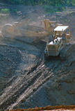 Strip Mining Coal Pit. Bulldozer pulling coal stripper back into the pit royalty free stock photo