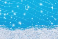 A strip of natural snow on blue glass  winter background Royalty Free Stock Image